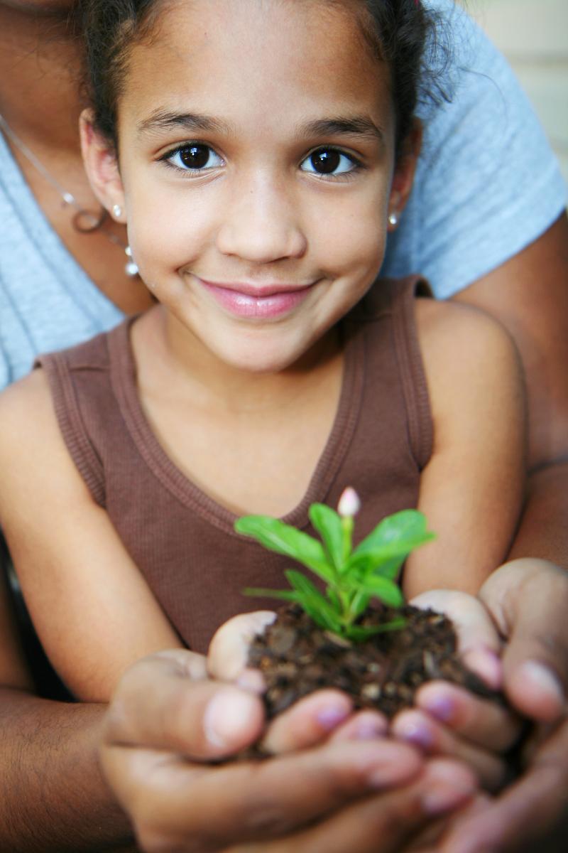 Girl planting flower