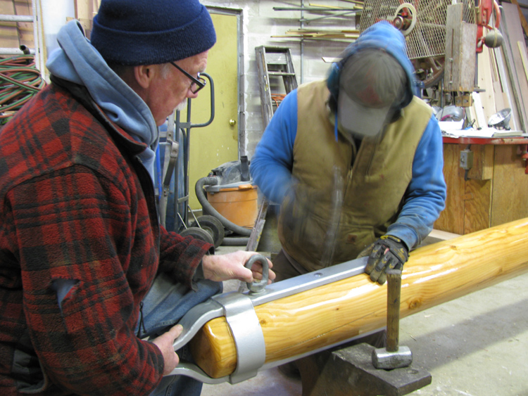 Fitting the ironwork on the new fore boom