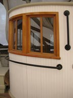 curved drop windows in pilothouse