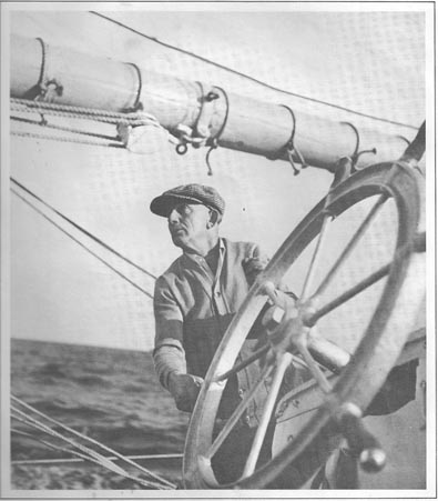 Capt. Angus Walters at the whell of the Bluenose