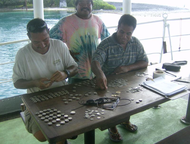 Kiripati natives checking the coffers
