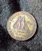 1938 commerative coin showing the Bluenose