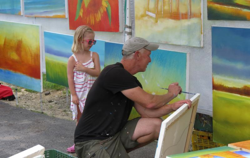 Young girl buying her first piece of art (c) Gerry Grabowski 2014