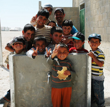 Oxfam photo of children in Jordan with water tap