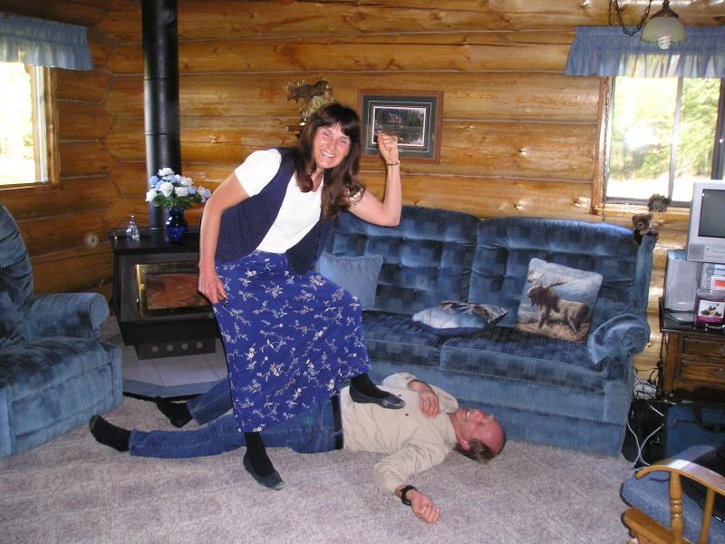 Jim under Sally's foot