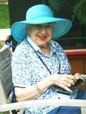 Resident dons blue sun hat.