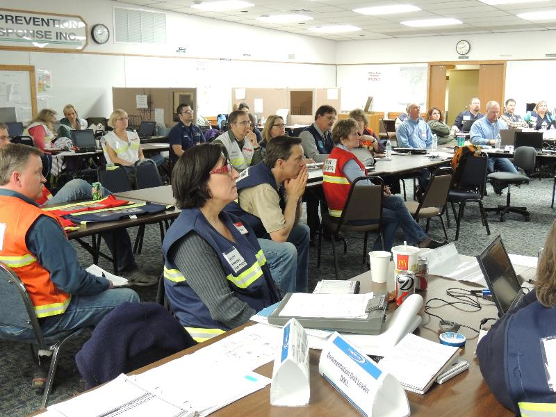 Drill participants go over spill scenario for Cook Inlet Pipe Line