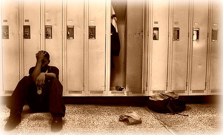 Student in front of lockers