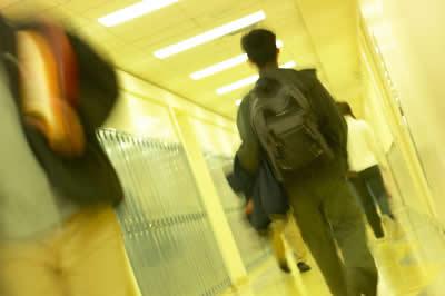 student-walking-hallway.jpg