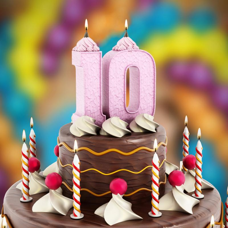 Birthday cake with number 10 lit candle.