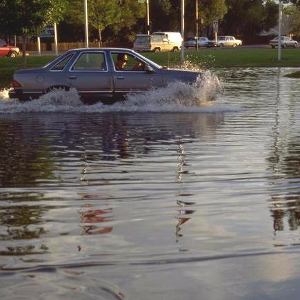 Photo of a Car Driving Through Water