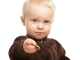 child holding coin