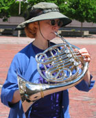 Photo of composer Pamela Marshall playing horn