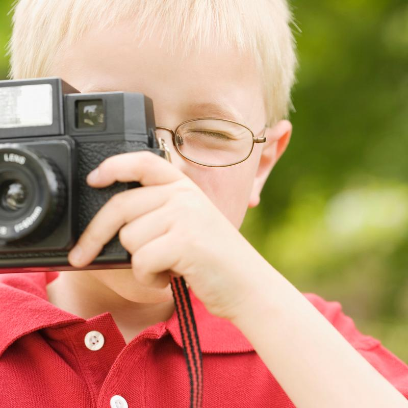 Kid taking picture