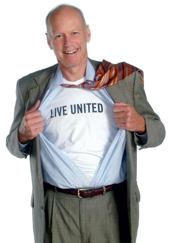 man in suit with LIVE UNITED Shirt