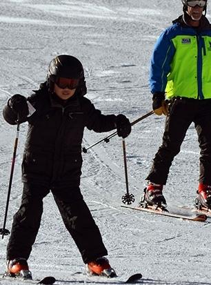 Having fun sliding down the mountain on skis.