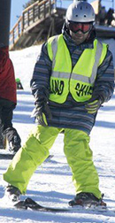 Blind skier enjoying the slopes.