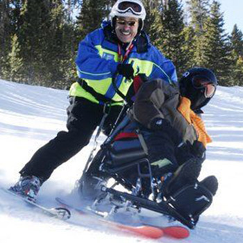 Nick enjoying the snow on a bi-ski .
