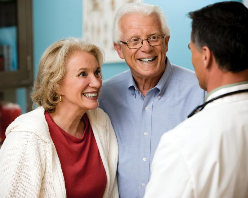 Older couple with doctor