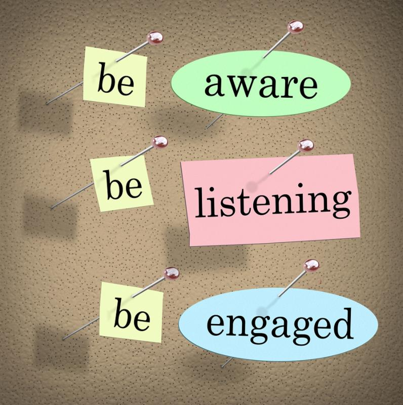 Be Aware, Listening and Engaged words on papers pinned to a bulletin or message board to illustrate the need to pay attention when managing an organization