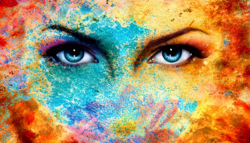 A pair of beautiful blue women eyes beaming color rust effect painting collage violet makeup