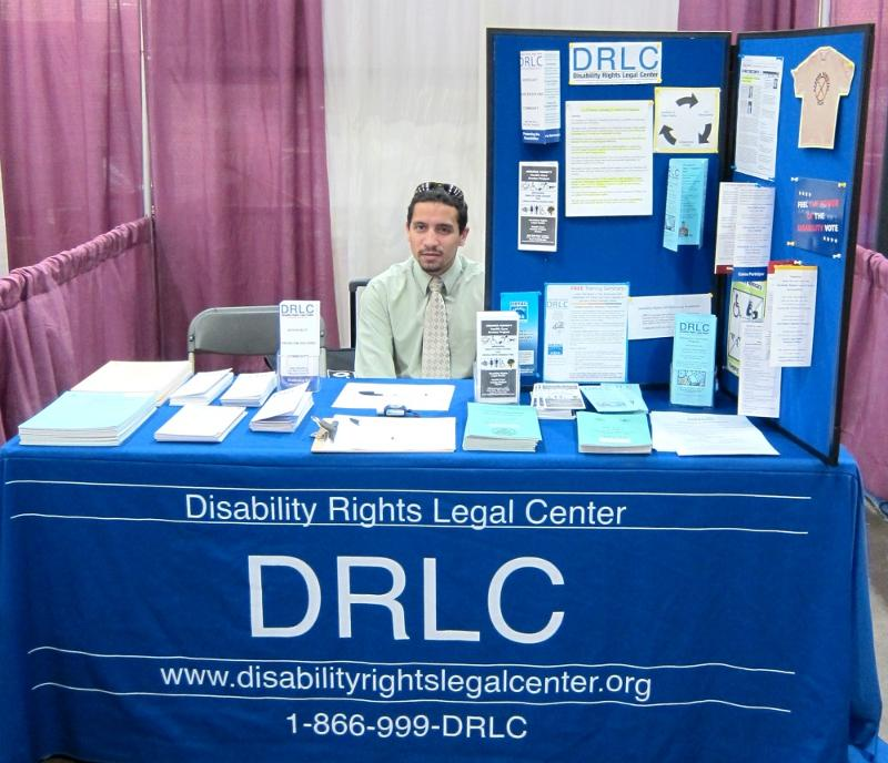 Volunteer staff DRLC table at LA Abilities Expo