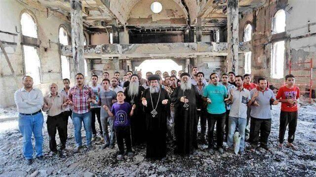 Coptic congregation worship in burnt-out church