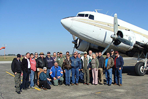Group Shot by Plane