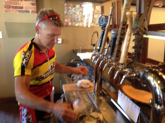 Pouring a beer after a bike race