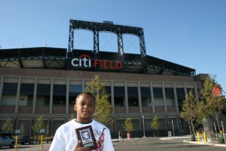 Raymond shows his souvenir in front of CitiField