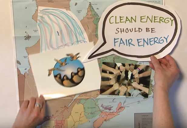 Still frame from video shows a map of Labrador with a drawing of a waterfall_ the FemNorthNet logo_ and women_s hands joined to form a circle. A speech bubble reads _Clean energy should be fair energy_.