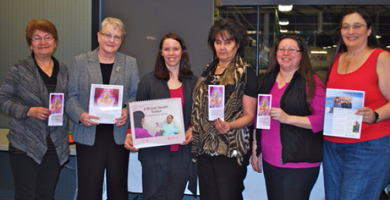 The six women recognized for their work to increase breast cancer screenings in Thompson pose for a photo together.
