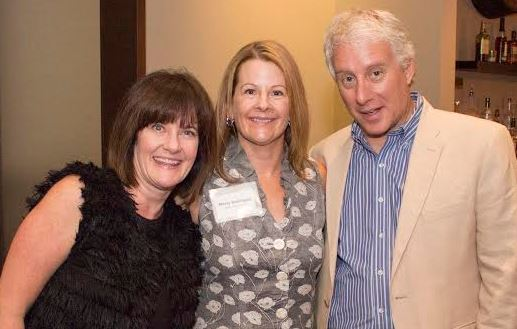 Leadership Society Member Molly Defilippis and guest Jill Kohler with David Brancaccio
