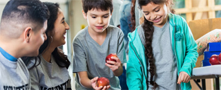 image of children sharing apples