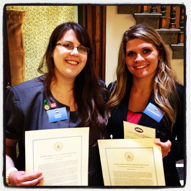 Stephanie Orlando and Lacy Kendrick hold Mental Health Month Proclamations