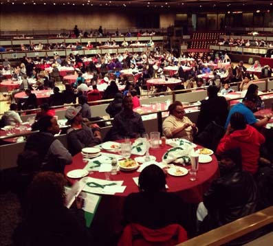 view of the convention center full of people seated at round tables