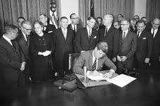 President Kennedy signing the Community Mental Health Act into Law