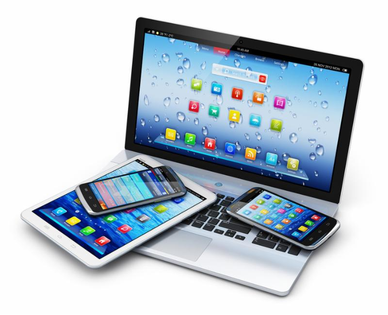 Mobile devices, wireless communication technology and internet web concept  business laptop or office notebook, tablet computer PC and modern black glossy touchscreen smartphones with colorful application interfaces isolated on white background