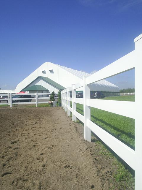 white fence and arena