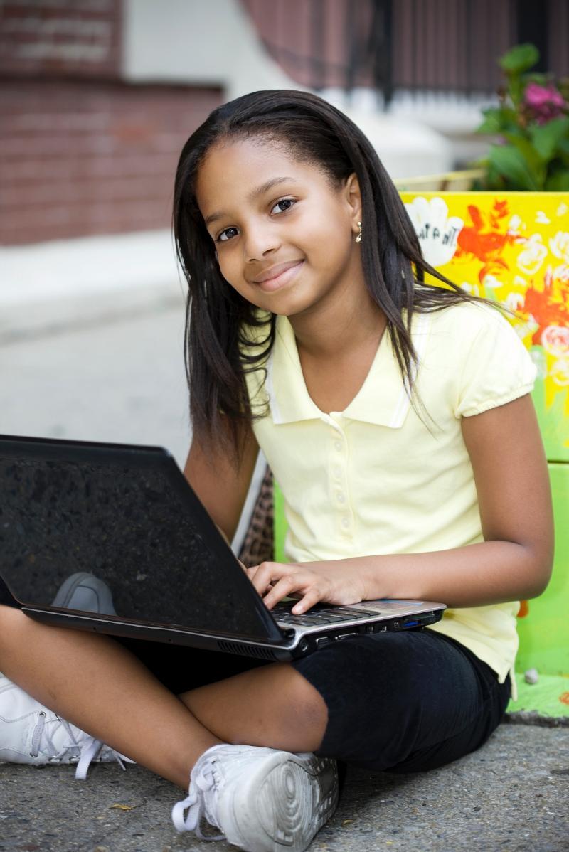 Girl with Laptop Yellow Shirt