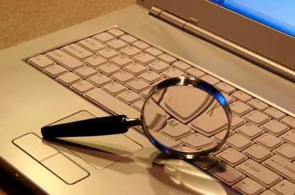 MagnifyingGlass&Laptop