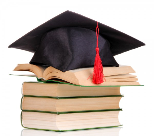 Graduate Cap onto of books
