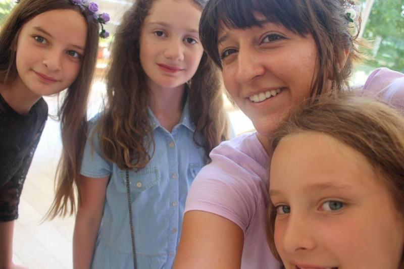 Pictured are Gabrielle Wildfeuer '15 and three of her Bosnian students.