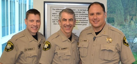 Chief Deputy Bill Steele, Sheriff Pat Garrett, and Undersheriff Jeff Mori