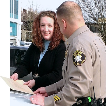 Detective Erika Cox confering with a deputy.