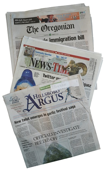 stack of newspapers 366x600