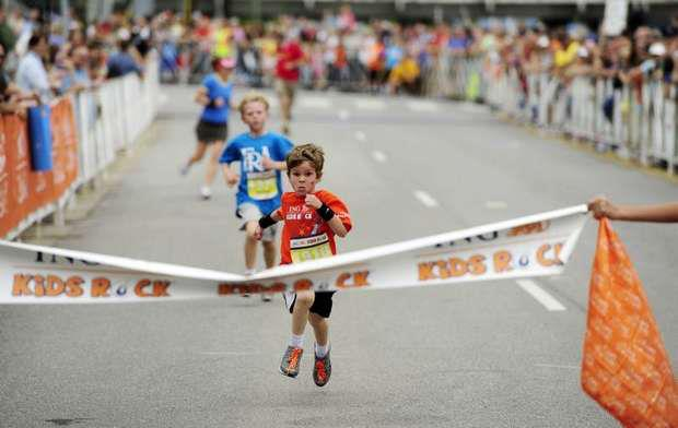 Young runner crosses his