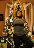 Monica Whittle holds tree of life yoga pose