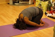 Monica Whittle holds the yoga child's pose.