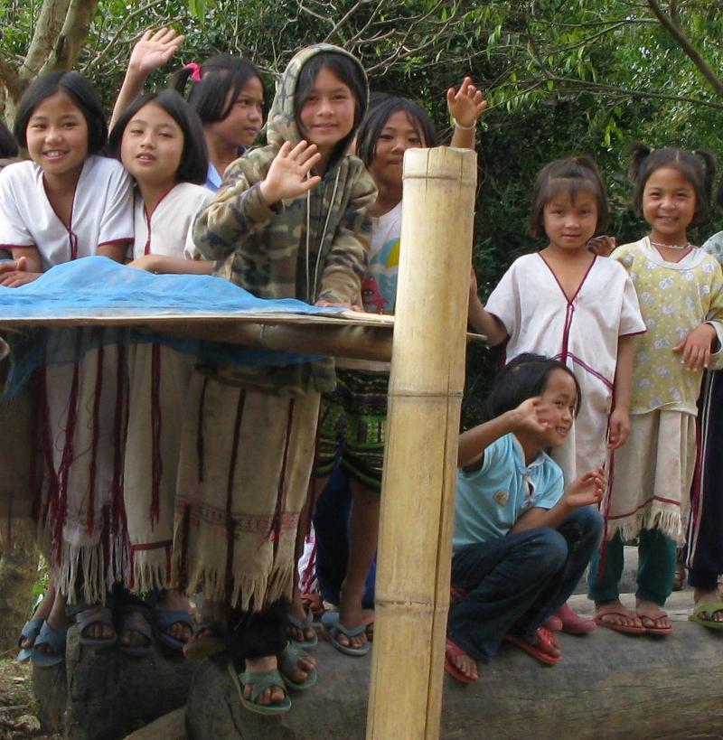 Thai hostel children standing on bamboo log